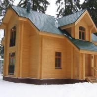 Дом из клееного бруса двухэтажный цвета дерева