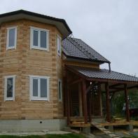 Готовый дом с эркером и террасой