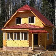 Дом из профилированного бруса двухэтажный с красной крышей