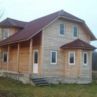 Дом из профилированного бруса с верандой и эркером